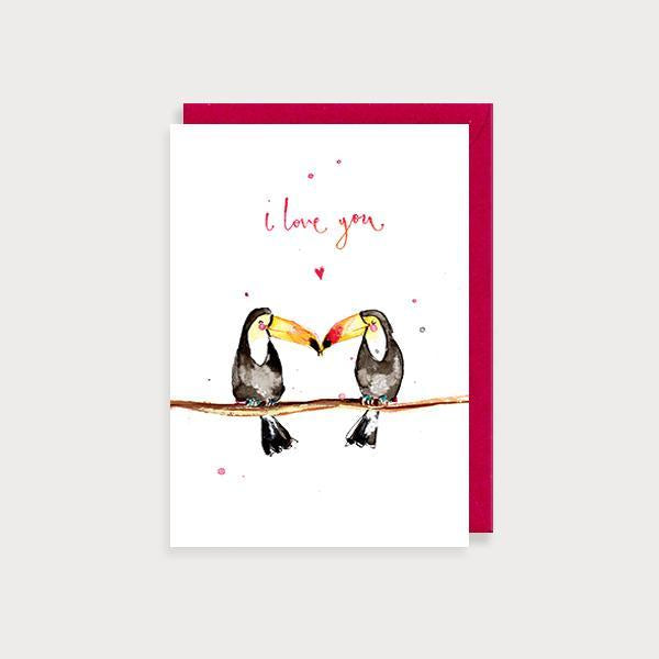 Image of illustrated anniversary or valentine's day card with 2 toucans kissing on a branch and the caption I Love You
