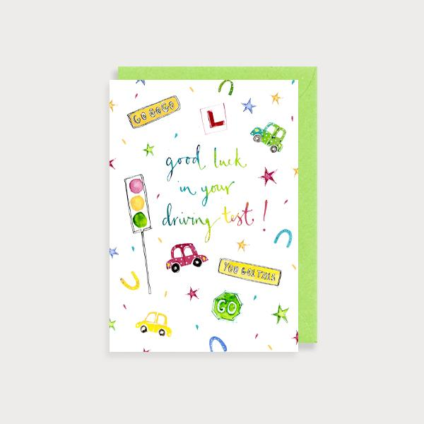 Image of illustrated card with a car and traffic lights and the caption Good Luck in your Driving Test