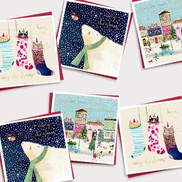 Image of bundle of illustrated Christmas cards with a winter house scene, cat and polar bear design