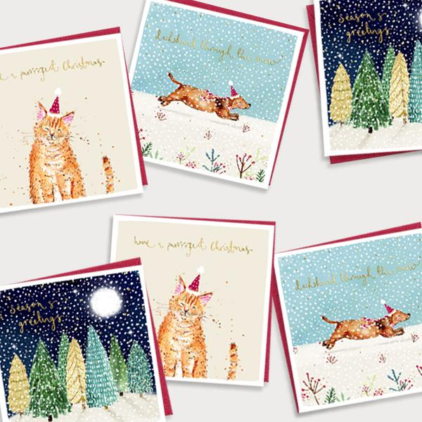 Image of bundle of illustrated Christmas cards with a christmas tree, cat and dog design