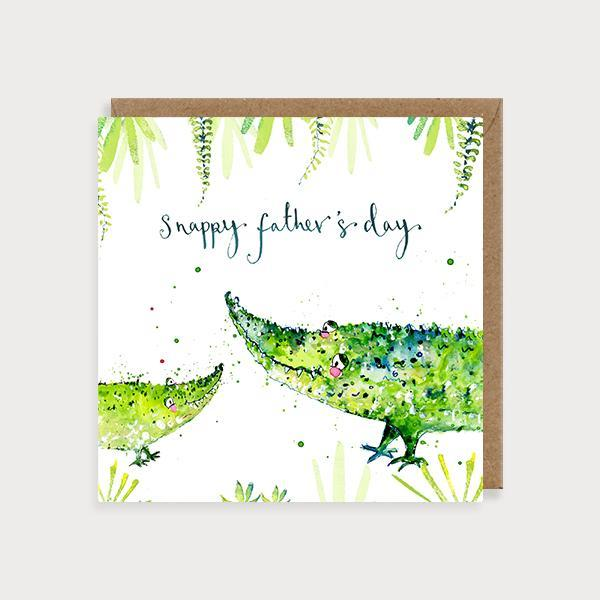 Image of illustrated father's day card with a crocodile and a baby crocodile in foliage and the caption Snappy Father's Day