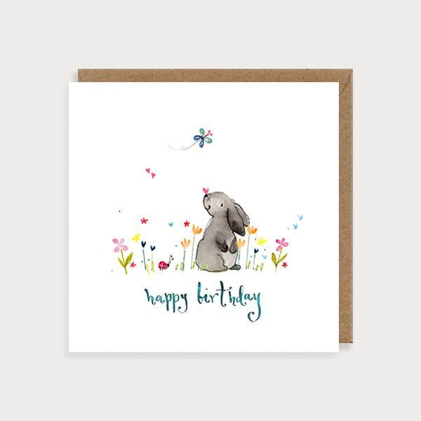 Image of illustrated birthday card with a bunny rabbit and flowers and the caption Happy Birthday