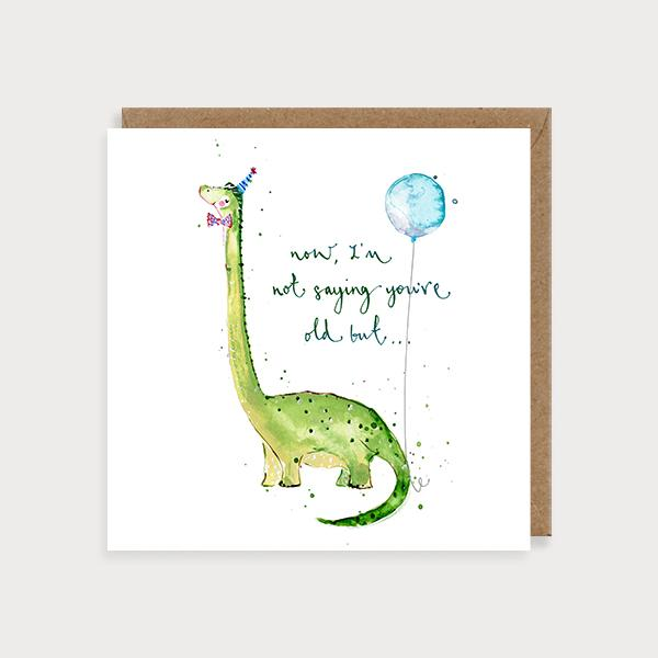 Image of illustrated birthday card with a brachiosaurus wearing a party hat and the caption Now, I'm Not Saying You're Old But