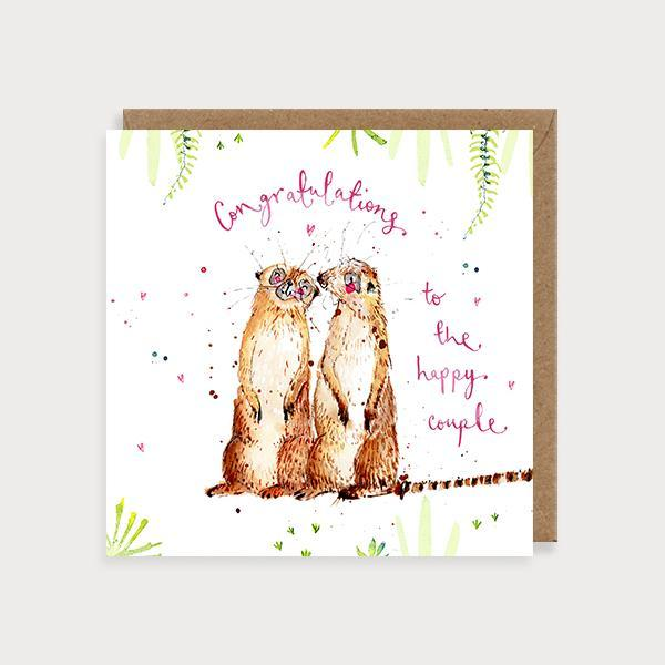 Image of ilustrated wedding card with 2 meerkats and the caption To The Happy Couple