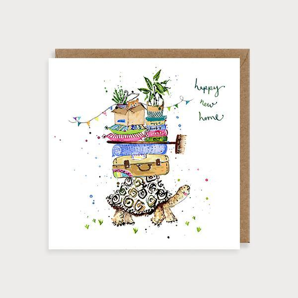 Image of ilustrated new home card with a turtle carrying suitcases, books, plants and boxes on its back and the caption Happy New Home