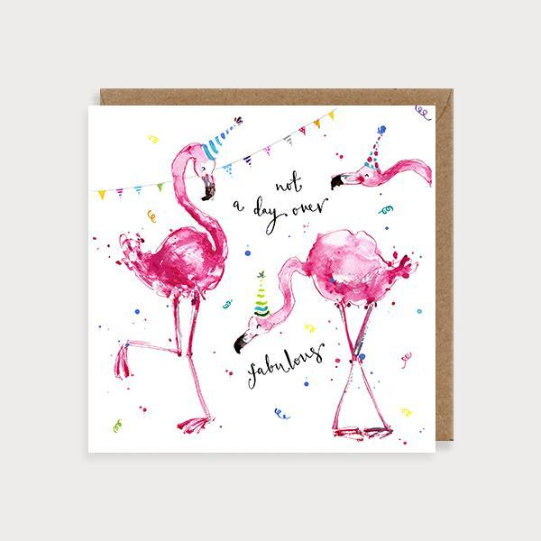 Image of illustrated birthday card with 2 flamingos wearing party hatsand the caption Not a Day Over Fabulous