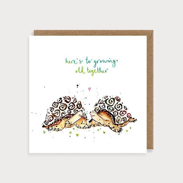 Image of illustrated anniversary card with 2 turtles holding hands and the caption Here's to Growing Old Together