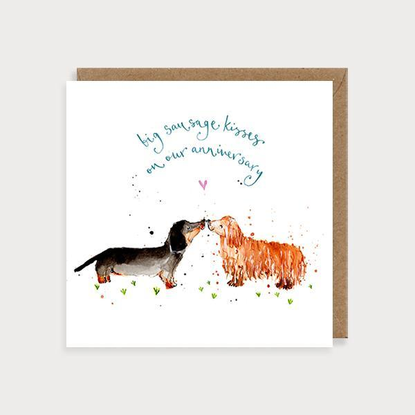 Image of illustrated anniversary card with 2 sausage dogs kissing and the caption Big Sausage Kisses on our Anniversary
