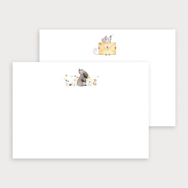 Image of illustrated notecard set with one bunny and flower design and a separate mouse holding an envelope design