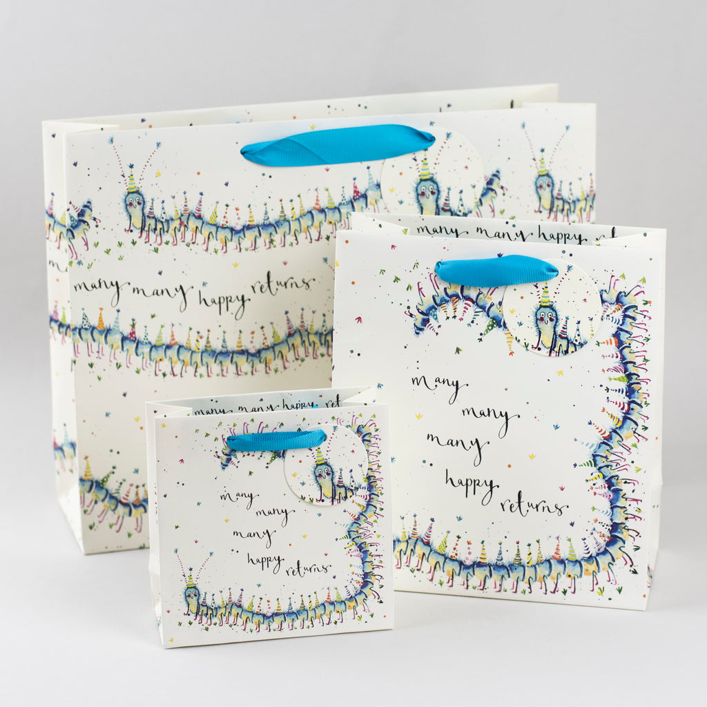 Image of illustrated 3 centipede birthday gift bags with the caption Many Many Happy Returns