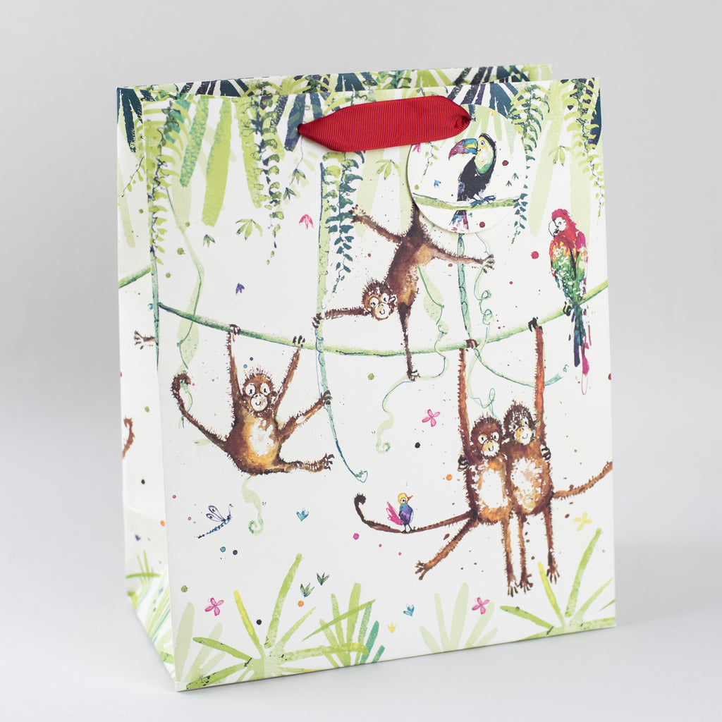 Image of illustrated jungle monkey themed birthday gift bag