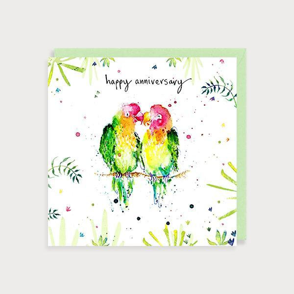 Image of illustrated anniversary card with 2 coloruful Love Birds on a branch and jungle foliage and the caption Happy Anniversary