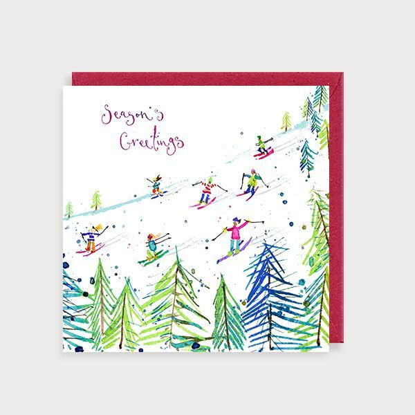 Image of illustrated christmas card with a skiing scene and the caption Season's Greetings
