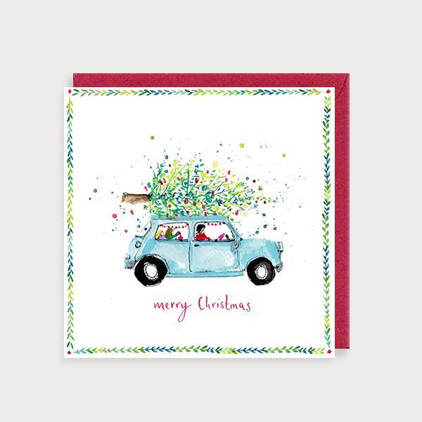 Image of illustrated christmas card with a car carrying a tree and the caption Merry Christmas Car and Tree