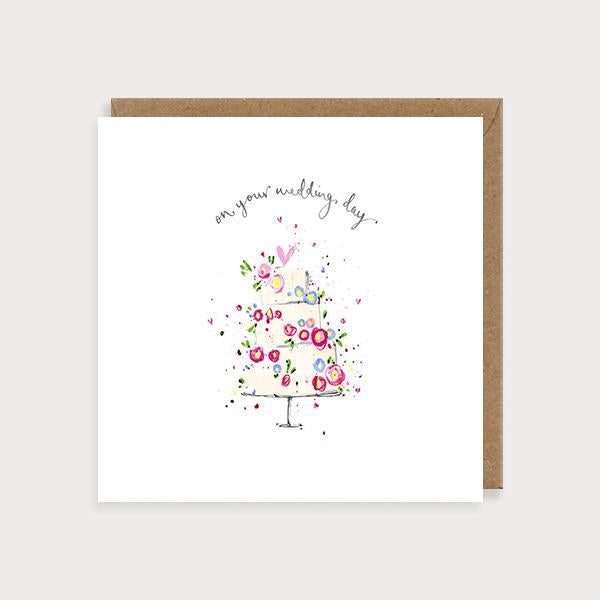 Image of ilustrated wedding card with a floral wedding cake and the caption on Your Wedding Day