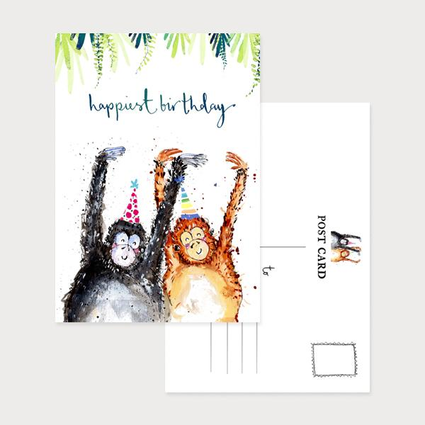 Image of an illustrated portrait postcard with 2 monkeys in party hats and their arms in the air with the caption Happiest Birthday