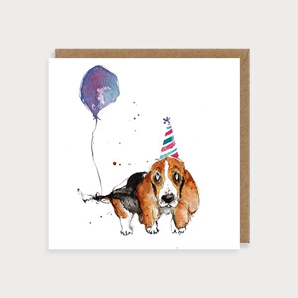 Image of illustrated birthday card with a basset hound in a party hat and a balloon