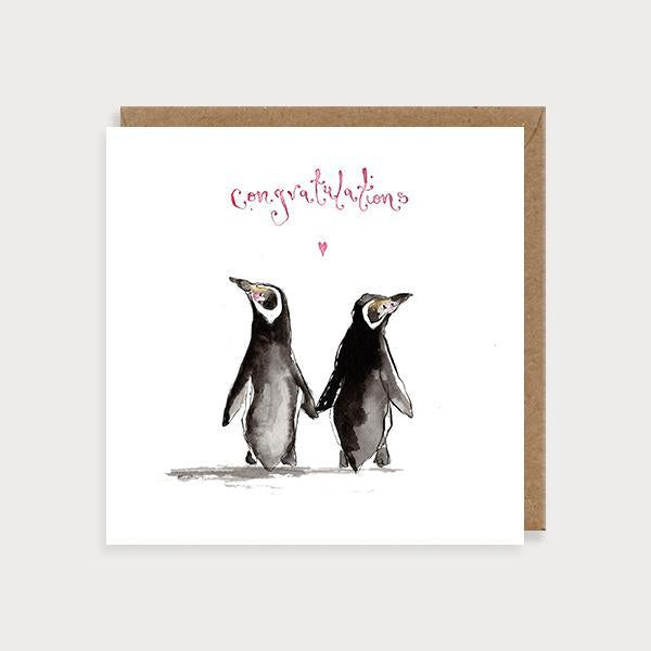 Image of ilustrated wedding card with 2 penguins holding hands and the caption Congratulations