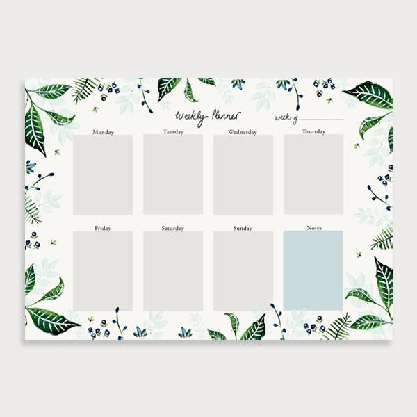 Image of illustrated weekly planner pad with a foliage leaf border. It has a title of Weekly Planner and has seperate boxes for the days of the week and a note section