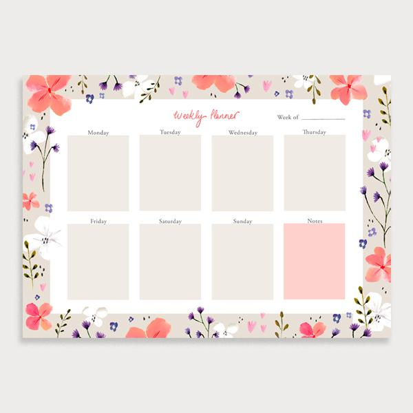 Image of illustrated weekly planner pad with a coral coloured floral border. It has a title of Weekly Planner and has seperate boxes for the days of the week and a note section