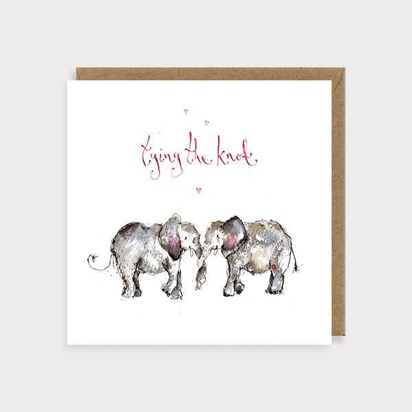 Image of ilustrated wedding card with 2 elephants with their trunks entwined and the caption Tying The Knot