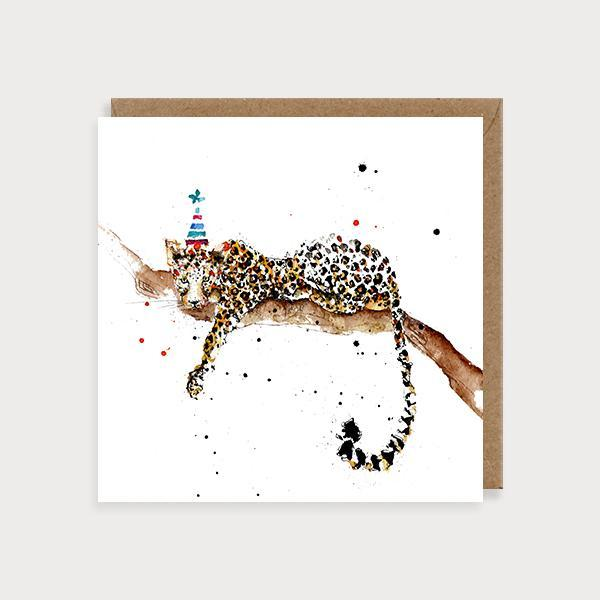 Image of illustrated blank birthday card with a leopard in a tree wearing a party hat