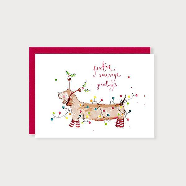 Image of illustrated christmas card with a sausage dog in fairy lights and the caption Festive Sausage Greetings