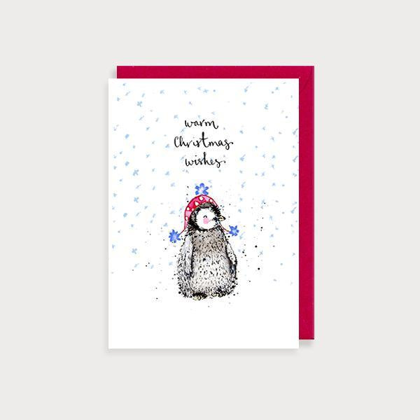 Image of illustrated christmas card with a baby penguin in a woolly hat and the caption Warm Christmas Wishes