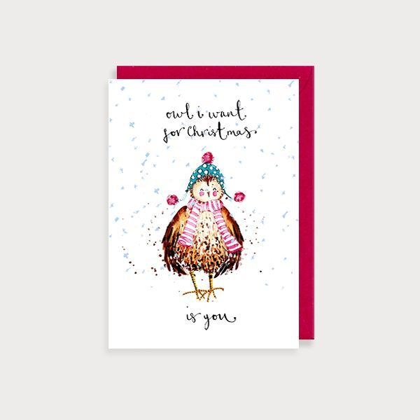 Image of illustrated christmas card with an owl in a scarf and hat and the caption Owl I want for Christmas