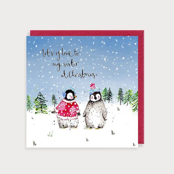 Image of illustrated christmas card with 2 penguins in a jumper and hat and the caption Lots of Love to my Sister at Christmas