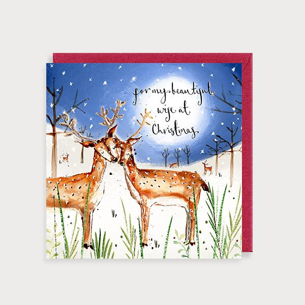 Image of illustrated christmas card with 2 deers in a snow scene at night and the caption For my Beautiful Wife at Christmas