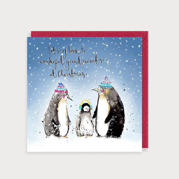 Image of illustrated christmas card with 2 penguins and a baby in woolly hats and the caption Lots of Love to Wonerful Grandparents at Christmas