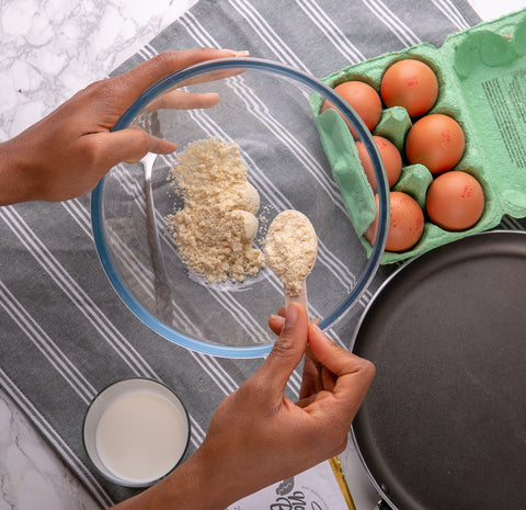 An image of our No Guilt Bakes Pancake and Waffle Mix being measured out into a medium bowl