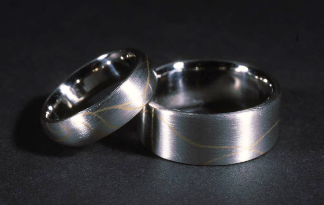 platinum wedding bands with 18K inlay
