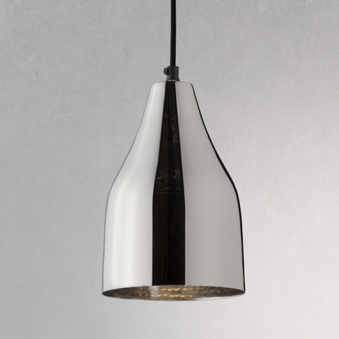 A semi-transparent silver triangular-shaped pendant light with a dimpled brass-coloured interior hanging on a single black cord