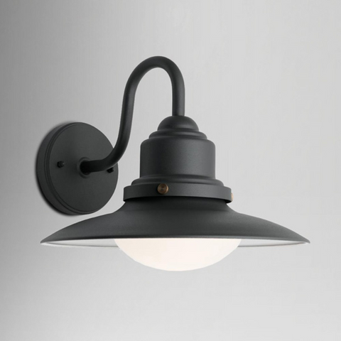Black steel wall light with curved arm and black shade and opal shallow glass bulb