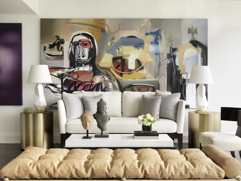 Living room with large abstract print on the wall and two lamps