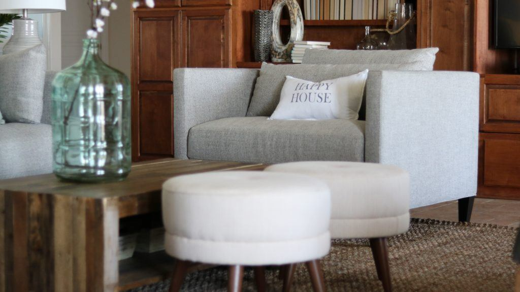 Coastal living room with grey tone furniture and textiles