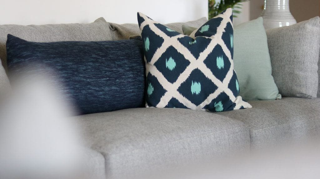 Cranbrook mint ceiling fan pairs with blue tone pillows