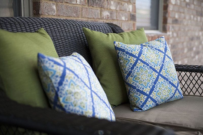 Hunter Fan Company updated patio with green and blue accent pillows