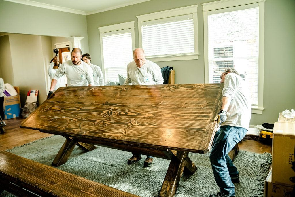 Hunter Fan Company employees moving a bench during the Dorothy Day House of Memphis Huntervention