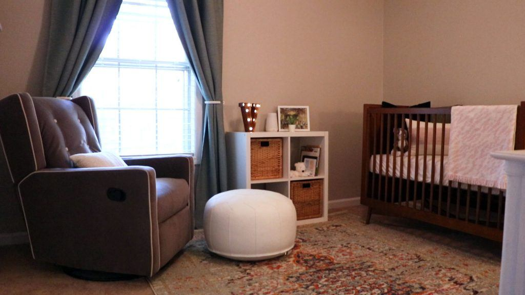 Modern boho nursery with Moroccan pouf and bohemian rug featuring Hepburn Hunter copper ceiling fan with LED light