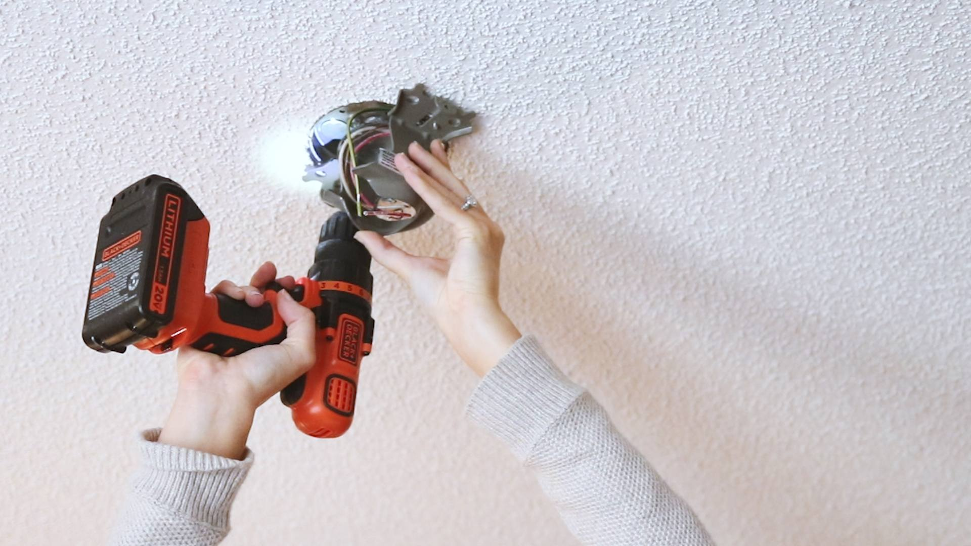Hunter installing a ceiling fan where no light fixture existed
