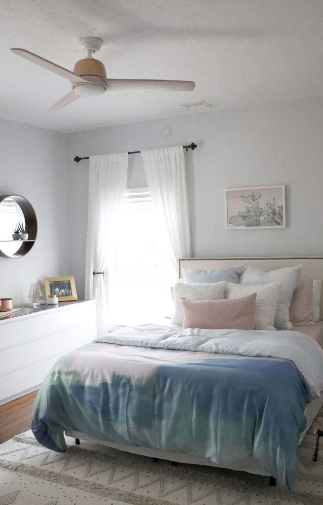 Huntervention Palm Springs AirBnB modern guest bedroom with blue and blush pink bedspread