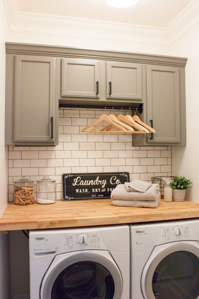 farmhouse laundry room with grey cabinets