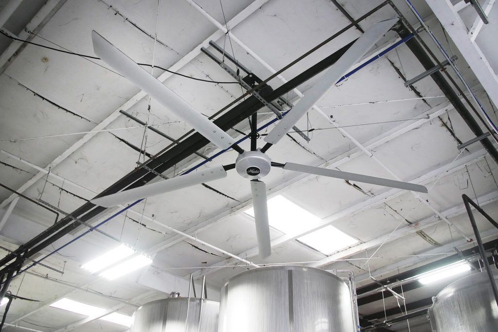 The Titan 16' industrial ceiling fan hangs from the ceiling of the Yazoo Brewery in Nashville.