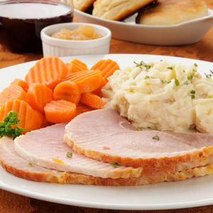 Honey Baked Ham with Mashed Potatoes, Glazed Carrots and a Dinner Roll