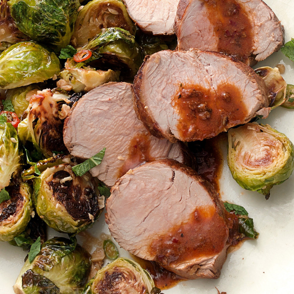 Pork Tenderloin with Brussel Sprouts, Rice Pilaf, Wild Mushroom Sauce and a Dinner Roll