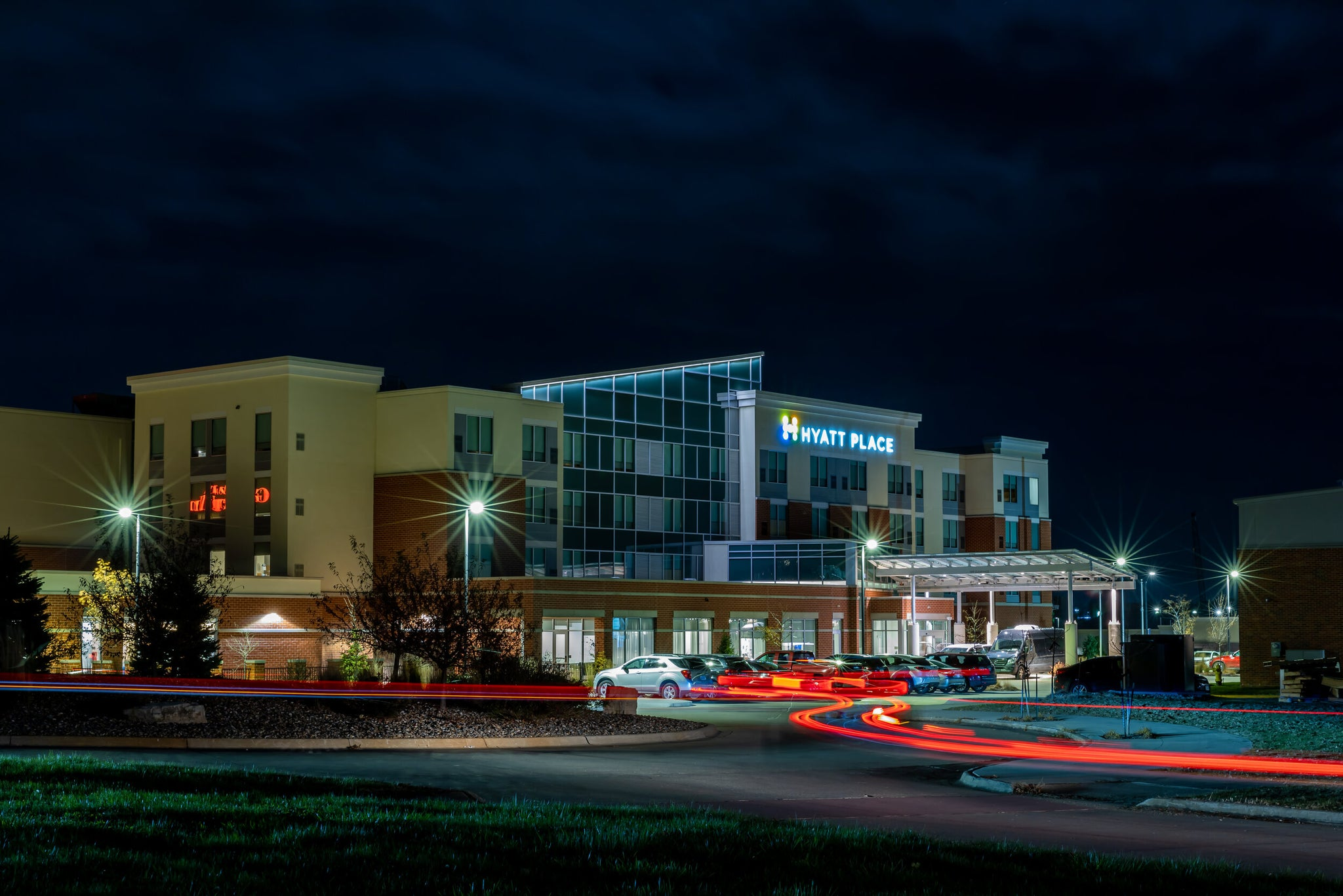 A long exposure shot of the outside of the Hyatt Place