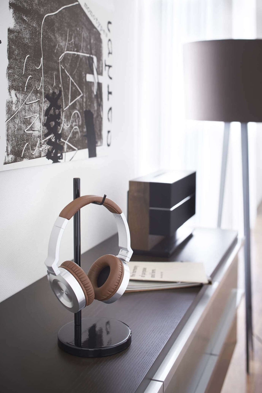 Yamazaki headphone stand holding headphones on a dresser